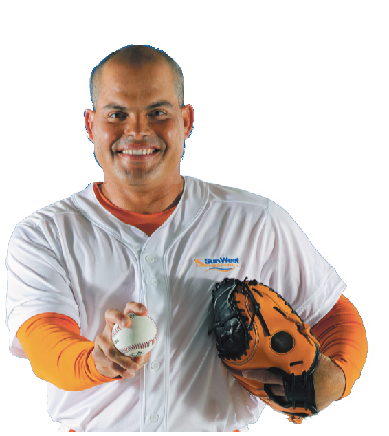 Ivan Rodriguez posing with a baseball globe and ball.